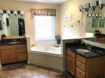 Full Master bath with walk in Shower. Separate double sinks.