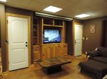 Game Room Located Downstairs with Flat Screen TV, Sofa and Over Size Chair with Ottoman