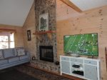 Living area has a 55 inch Flat Screen TV with Gas Fireplace