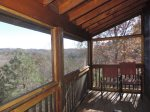 French doors lead to Screened in Deck with Long Range view with chairs