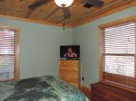 Queen Size Bed Upstairs with Dresser and Flat Screen TV