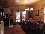 French Doors Lead to Screen In back Porch with Wood Burning Fire Place