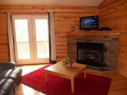 The master bedroom is on the main floor with a Queen bed, chest of drawers and private full bath.