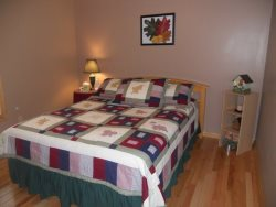 The open downstairs area has a Queen sleeper sofa, reclining chair, TV and stereo system.