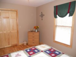 The downstairs also has a card\/game table, writing desk, wireless internet access and Queen sized futon sleeper.
