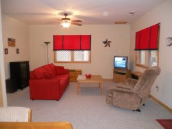 The hot tub is on the downstairs outside deck level.
