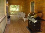 Screened in Upper Deck off the Kitchen with BBQ Gas Grill and 2 patio tables with 8 chairs