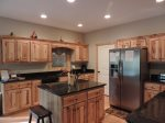 Fully stocked kitchen with center island and bar stool seating for 2