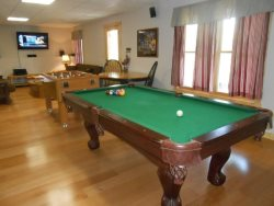 Game room has pool table, Foosball table,40 inch Flat Screen TV, Dart Board