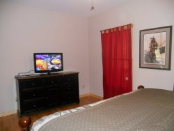 Flat screen TV and dresser in the Master Bedroom