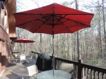 Back Deck has 2 patio Tables that seat 10 with 2 extra chairs. Both Umbrella`s have lights.Gas BBQ Grill