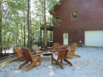 Back Deck has 2 patio Tables that seat 10 with 2 extra chairs. Both Umbrella`s have lights. Gas BBQ Grill.