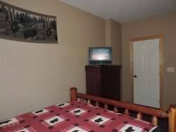 60 inch Flat Screen TV in the Game room with Queen Size Sleeper Sofa