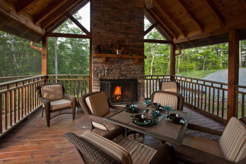 Mountain resort cabin rentals wilderness lodge for Screened in porch fireplace ideas