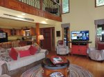 Living Room also has a 40` Flat Screen TV with Wood Burning Fire Place