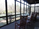 Screened in Porch also has a Picnic Table and Porch Swing