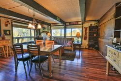 F1: This condo has fun lodge decor with a fireplace, and a view of the Roaring Fork Valley.