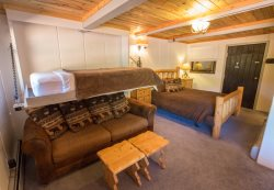 Charming log furniture and nice lodge decor make this condo very comfortable.