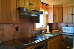 Main Cabin Kitchen with Induction Stove and Drawer Refrigerator no freezer
