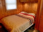 Main Cabin Bedroom has a Full Bed