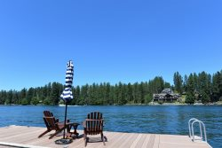 WOW, right on the Spokane River with sandy beach and dock.  Incredible outdoor living spaces for the perfect summer vacation.
