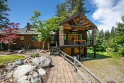 Hayden Lake Lodge, an incredible cabin on Hayden lake with amazing panoramic views, private peninsula living, lake front with dock, beach and hot tub.