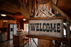 Authentic lake cabin on Lake Coeur d`Alene. Incredible log home with stunning lake view, dock and private community beach.