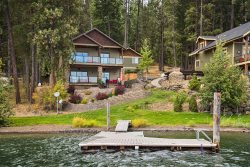 Stunning home on Lake Coeur d`Alene, nearly level to the water and easy access to the lake, dock and beach, best bay for water sports