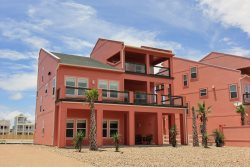 Discover this beautiful beachfront vacation home in Port Aransas  on Mustang Island and the scenic views and unforgettable sunrises from the 2nd and 3rd story decks.