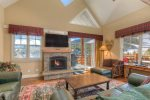 Living room with Lone Peak views, stone fireplace, vaulted ceiling, hardwood floors, and plenty of seating