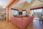 Large living room with Lone Peak views, gas fireplace, flat screen TV and surround sound