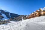 Large sectional sofa with hardwood floors, log accents, and plenty of seating