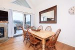 Dining table with fabulous views - walks out to upper deck with seating and gas grill.