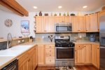 Full kitchen with all appliances and cooking utensils - perfect for any occasion.