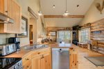 This cabin with the Big Sky valley and more ski slopes in the background.