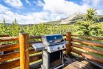 Gas grill on upper deck.