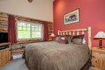 Master suite with King Bed and flat screen TV, separate vanity & private bath.