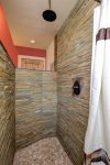 Large custom shower in master suite.