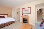 Queen Log Bed in Bedroom 2 with twin/twin bunk beds, flat screen TV, and private bath.