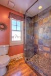 Large, walk-in slate shower in master suite