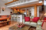 Large open living room/dining room with gas fireplace and amazing views.
