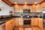 Kitchen with granite counters, breakfast bar for 3, all appliances and supplies.