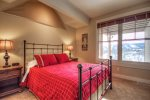 Bedroom Suite 2 with breathtaking views, queen bed, private bath, and TV.