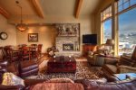 Large open great room, flat screen TV, wood burning fireplace, views of slopes.
