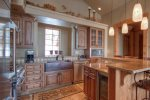 Fabulous kitchen with bar seating for 4, high end stainless appliances, open to living room.