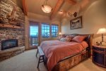 Master Suite 1 on main level with King Bed, Gas Fireplace, Large Private Bath, TV and Views.