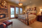 Master Suite 2 on lower level with King Bed, Private Bath, and Gas Fireplace.