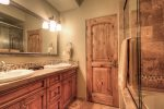 Private bath for Master Suite 2 with bathtub/shower and double vanity  heated floors