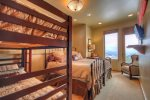 Another view of Bedroom Suite 4 with twin bunk and king bed.
