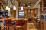 Gourmet Kitchen with separate wine cooler, breakfast bar, and heated floors.